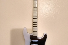 Stratocaster on the wall.